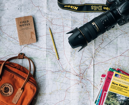 Photo of map and travel items representing uk travel