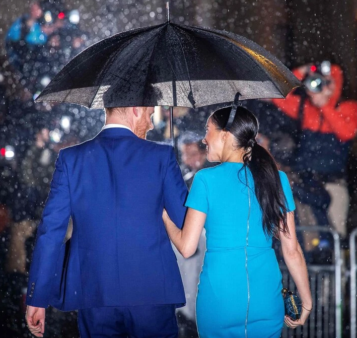 Photo of Meghan Markle and Prince Harry walking in the rain