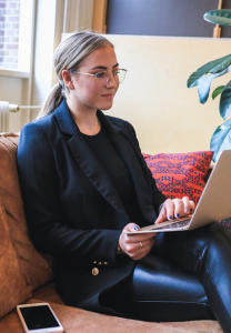 Photograph of a job seeker seated with laptop
